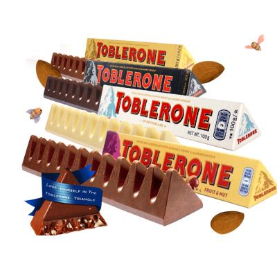 瑞士進口Toblerone三角巧克力含巴旦木蜂蜜牛奶葡萄干白黑巧克力100gX4條組合套餐